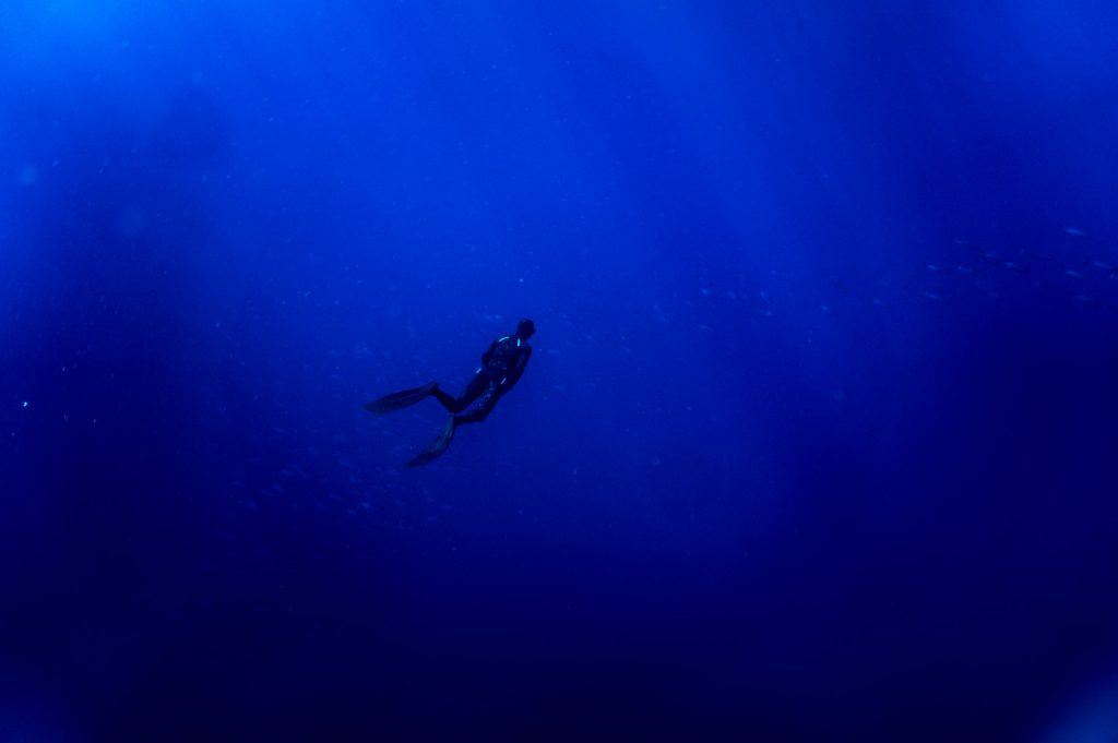 Freediver going diving deep