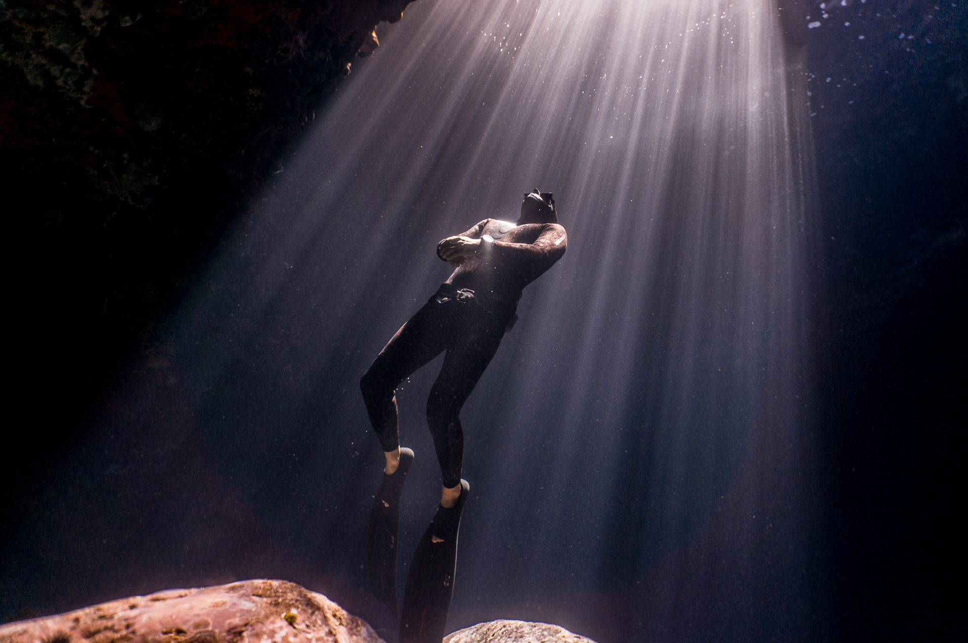 Freedive instructor on  a cave